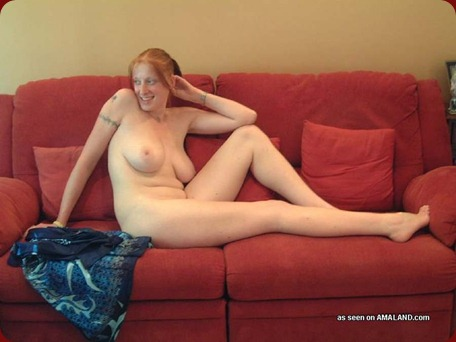 busty milf posing on couch